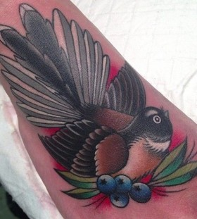 Bird and blueberries tattoo by Clare Hampshire