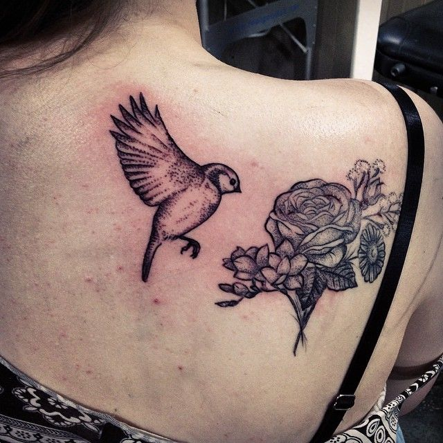 Bird and flowers back tattoo by Rebecca Vincent