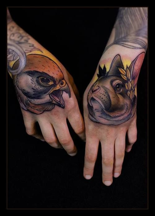 Bird and rabbit hand tattoos
