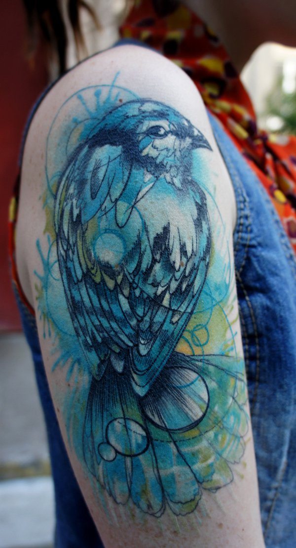 Bird healed watercolor tattoo