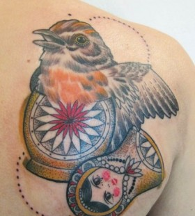 Bird inside matryoshka tattoo