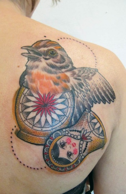 Bird inside matryoshka tattoo