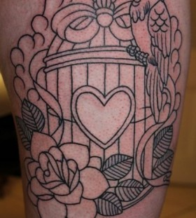 Birdcage and bird leg tattoo
