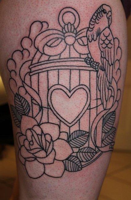 Birdcage and bird leg tattoo