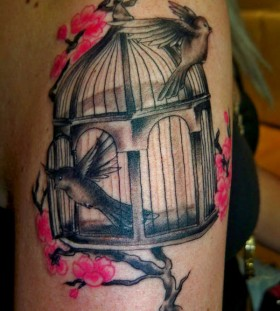 Birdcage and cherry blossom tattoo