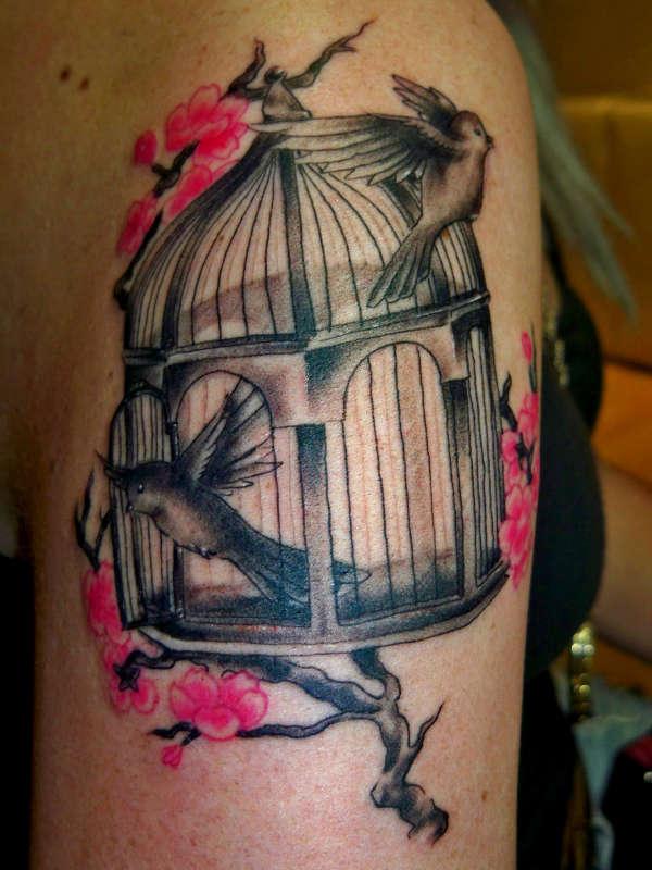 Birdcage and cherry blossom tattoo