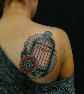 Birdcage and flower back tattoo