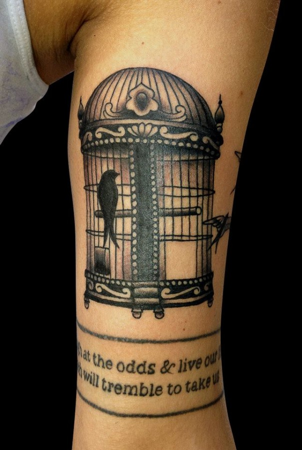 Birdcage and quote tattoo