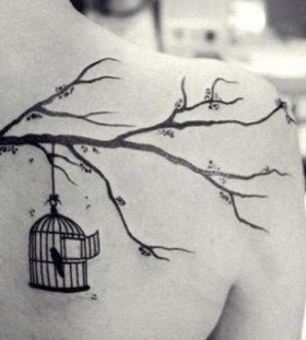 Birdcage and tree branch tattoo