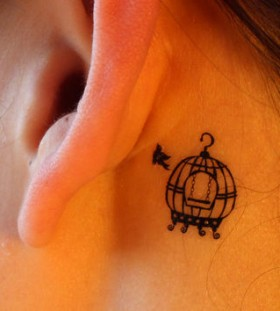 Birdcage behind ear tattoo