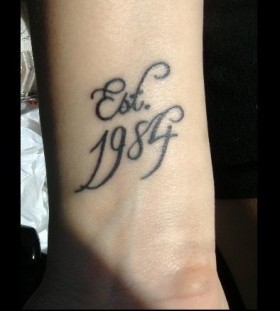 Birth black numbers tattoo