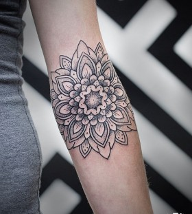 Black adorable hand's mandala tattoo