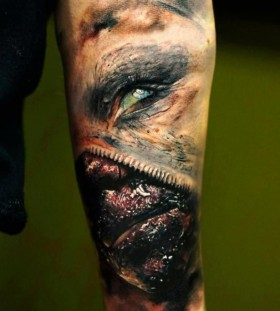 Black and blue scary tattoo