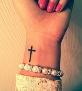 Black cross wrist tattoo