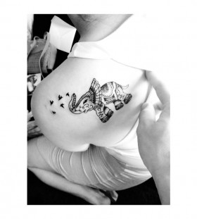 Black elephants and tribal bird tattoo