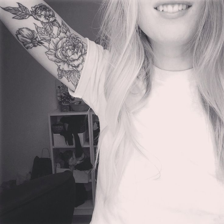 Black flowers arm tattoo