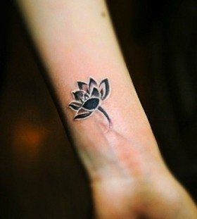Black flowers wrist tattoo