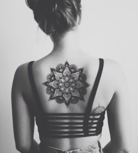 Black girl's back mandala tattoo