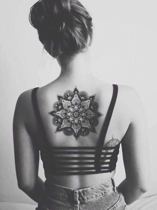Black girl's back mandala tattoo