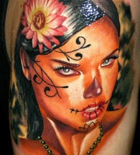 Black hair santa muerte girl with pink flower tattoo