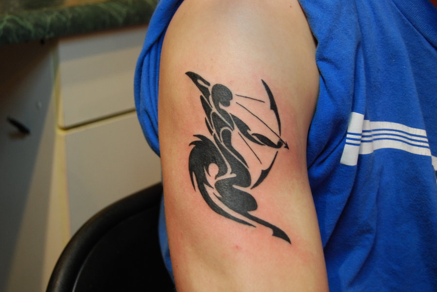 Black ink archer tattoo