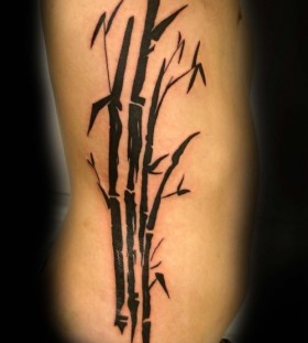 Black ink bamboo tree side tattoo