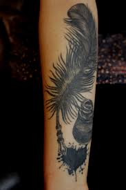 Black ink feather pen tattoo