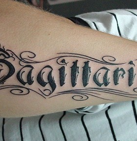 Black ink sagittarius tattoo