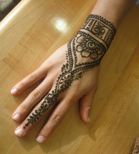 Black mandala style wrist tattoo