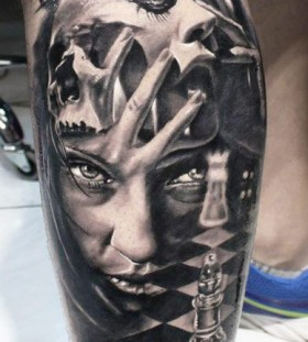 Black women's face and chess tattoo