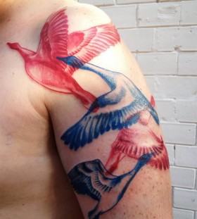Blue and red birds tattoos