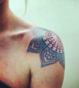Blue and red shoulder tattoo