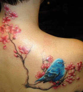 Blue bird and cherry blossom branch tattoo
