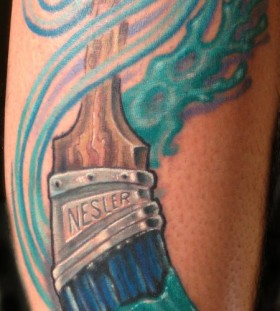 Blue coloured paint brush tattoo