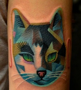 Blue geometric cat tattoo