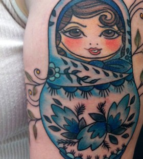 Blue matryoshka arm tattoo