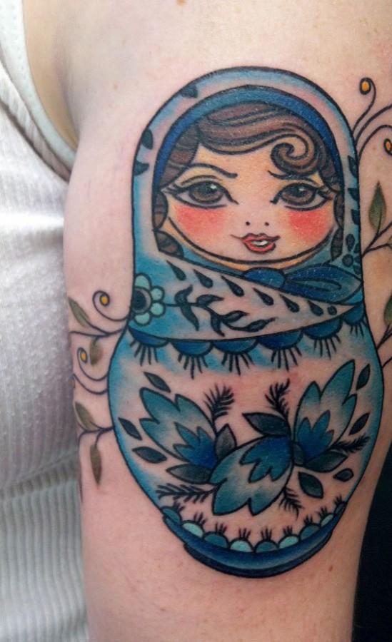 Blue matryoshka arm tattoo