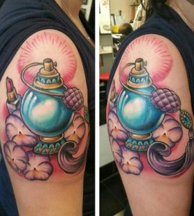 Blue perfume bottle arm tattoo