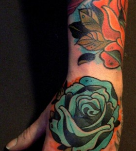 Blue rose tattoo by Lars Uwe Jensen