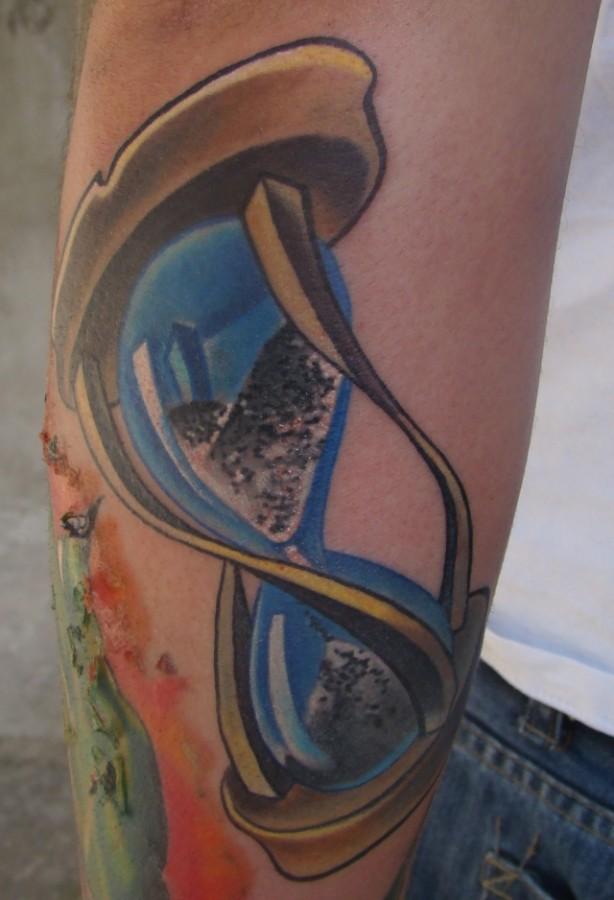 Blue sand clock tattoo