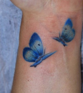 Blue wrist watercolor butterfly tattoo