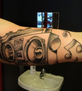 Boombox and music notes tattoo