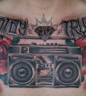 Boombox and roses chest tattoo