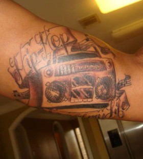 Boombox hip hop arm tattoo