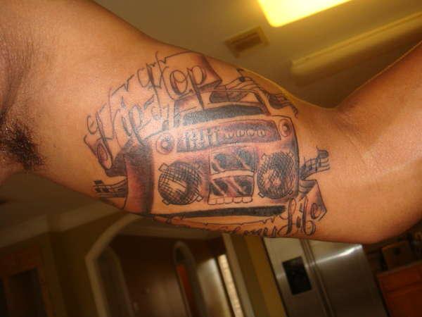 Boombox hip hop arm tattoo
