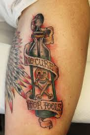 Bottle and quote leg tattoo