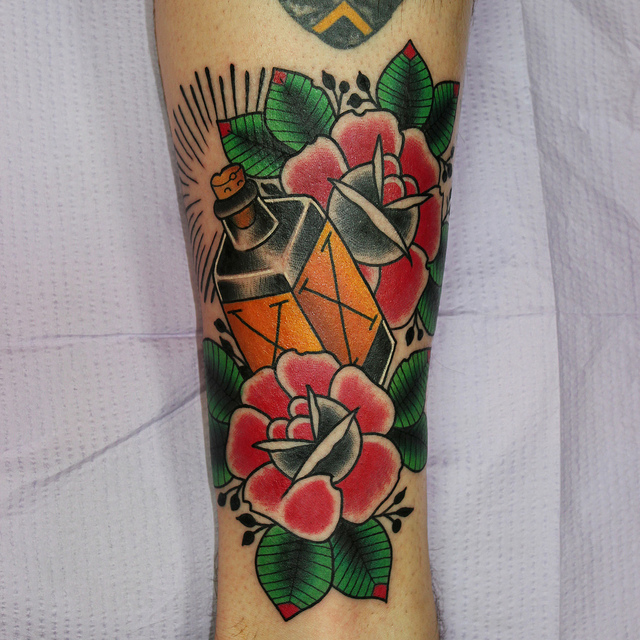 Bottle of poison and roses tattoo