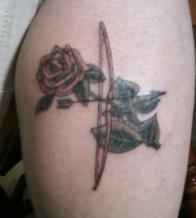 Bow and arrow rose tattoo