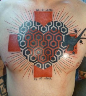 Brilliant chest tattoo by Yann Black