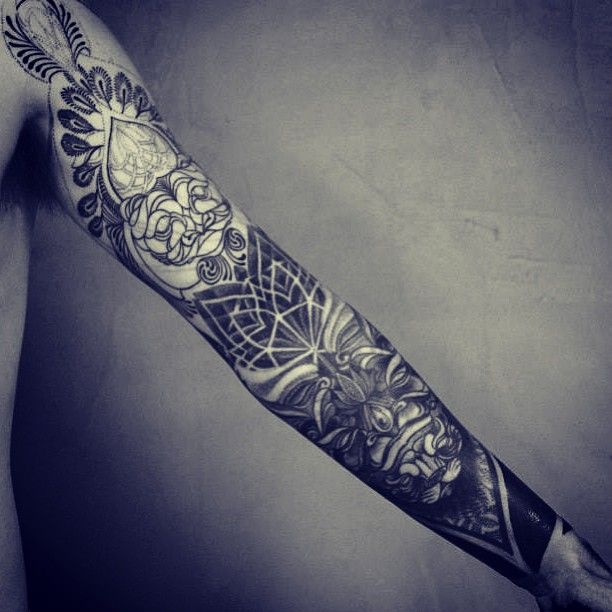 Brilliant full arm tattoo by Brian Gomes
